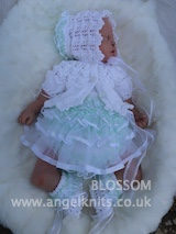 KSB..123. KNITTING PATTERN..BLOSSOM FOR A FRILLY ROMPER, PANTS, A BOLERO TOP AND MATCHING HAT AND BOOTIES IN 3 SIZES
