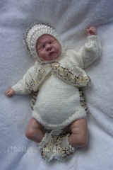 KNITTING PATTERN KSB..92 TO MAKE FRILLY FROU FROU....BODYSUIT, SHRUG, BONNET AND SHOES